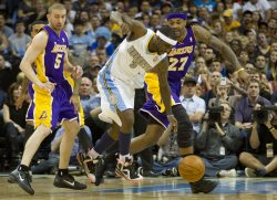 Nuggets Lawson Dribbles Past Lakers Blake and Hill During the NBA Western Conference Playoffs First Round Game Three in Denver