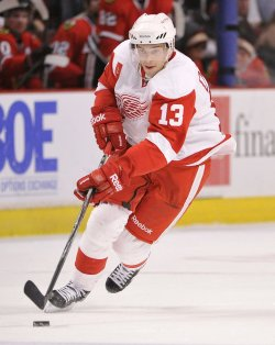 Red Wings Datsyuk skates with puck against Blackhawks in Chicago
