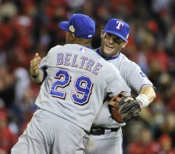 Rangers Beltre and Young hug after game 2 of the World Series in St. Louis