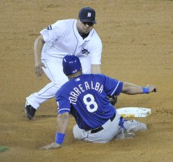 Tigers Peralta tags out Rangers Torrealba during ALCS in Detroit, Michigan