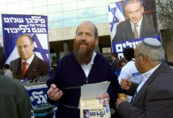 A LIKUD MEMBER CAMPAIGNS OUTSIDE A POLLING STATION IN JERUSALEM