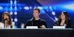 """""""The X Factor"""" judges Paula Abdul and Simon Cowell and top finalist Melanie Amaro atrend """"The X Factor"""" news conference in Los Angeles"""
