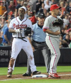 Braves' Michael Bourn tagged out at third