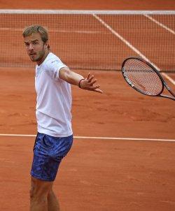 Andrej Martin of Slovakia throws his racket