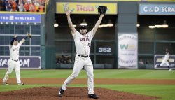 Astros McCullers raises arms in victory in the ALCS