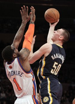 Indiana Pacers Tyler Hansbrough shoots a hook shot over New York Knicks Amar'e Stoudemire at Madison Square Garden in New York