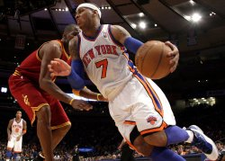 New York Knicks Carmelo Anthony drives by Cleveland Cavaliers Antawn Jamisonat Madison Square Garden in New York