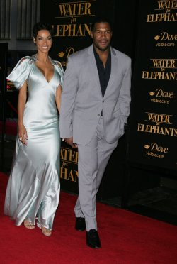"""Nicole Murphy and Michael Strahan arrive for the """"Water For Elephants"""" Premiere in New York"""