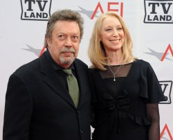 Tim Curry and Marcia Hurwitz arrive at the AFI Lifetime Achievement Awards in Culver City, California