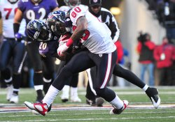 Raven Ed Reed brings down Texans' Andre Johnson in Baltimore