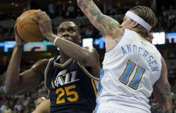 Jazz Jefferson Drives Against Nuggets Andersen in Denver