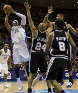Nuggets Anthony Shoots over Spurs Jefferson, Duncan and Mason in Denver