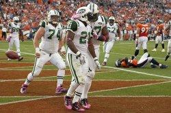 Jets Tomlinson Celebrates Against the Broncos in Denver