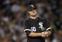 White Sox Danks rubs ball against Twins in Chicago
