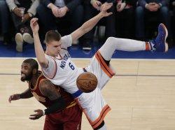 Knicks Kristaps Porzingis lands on Cavaliers Kyrie Irving