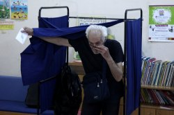 Greeks Vote in Crucial Referendum on Debt Deal
