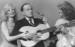 Actress Morgan Fairchild and country singer Dottie West try to teach Bob Hope how to play the guitar