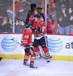 Blackhawks Kopecky, Dowell celebrate goal against Red Wings in Chicago