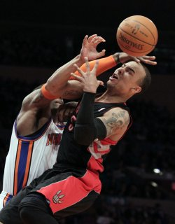 Toronto Raptors Jerryd Bayless is fouled by New York Knicks Amar'e Stoudemire at Madison Square Garden in New York