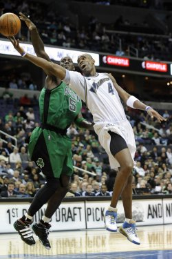 Antawn Jamison scores against Kevin Garnett in Washington