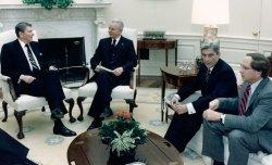 President Ronald Reagan meets with Senators Robert Byrd, John Warner and Sam Nunn