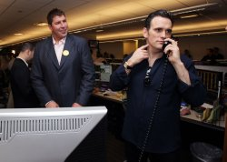 New York Giants David Diehl watches actor Matt Dillon say hello to a client at the 2010 BTIG Commissions for Charity Day in New York