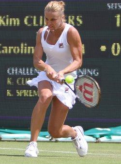 Karolina Sprem returns the ball on the third day of Wimbledon.