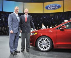 Ford and Mulally pose with 2013 Fusion at NAIAS in Detroit