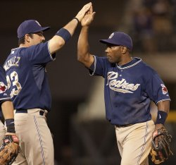 Padres Tejada and Gonzalez High Five After Win Over Rockies in Denver