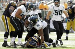 Jacksonville Jaguars Terrance Knighton (96) reacts after tackling New York Jets LaDainian Tomlinson at MetLife Stadium in New Jersey