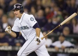 Seattle Mariners' Mike Sweeney tosses his bat as he grounds out to Detroit Tigers' third baseman Brandon Inge in the first inning.
