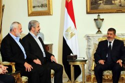 Egyptian President Mohamed Morsi meets Khalid Mashaal the Hamas Chief, And Gaza's Prime Minister Ismail Haniyeh.