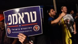 "A Man Holds A Sign In Hebrew Reading ""Trump"" At A Rally In Jerusalem"