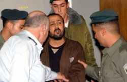 Israeli police lead Palestinian Tanzim leader Marwan Barghouti into Tel Aviv District Court