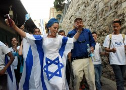 An Israeli Wears A National Flag Dress On Jerusalem Day