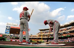 Phillies Placido Polanco and Jimmy Rollins warm up in Washington