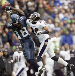 Baltimore Ravens cornerback Cary Williams, right, knocks the ball away from Seattle Seahawks wide receiver Sidney Rice.