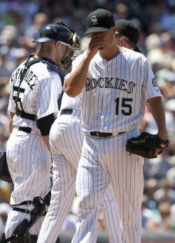 Rockies Pitcher Guthrie Relieved in Denver