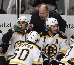 Bruins coach Julien talks with Sobotka against Blackhawks in Chicago