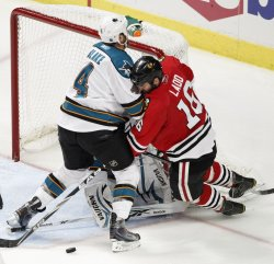 Sharks Blake checks Blackhawks Ladd in Chicago