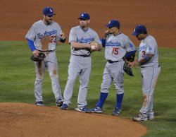 Members of the L.A. Dodgers meet with Randy Wolf during game four of the NLCS in Philadelphia