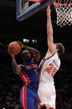 New York Knicks Timofey Mozgov plays defense on Detroit Pistons Ben Gordon at Madison Square Garden in New York