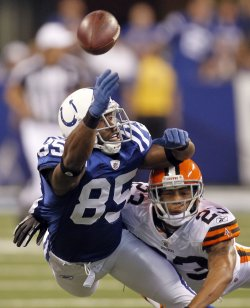 Colts Wayne Reaches for Pass As Browns Haden Defends