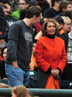 Speaker of the House Nancy Pelosi talks to San Francisco Mayor Gavin Newsom during game 2 of the World Series in San Francisco