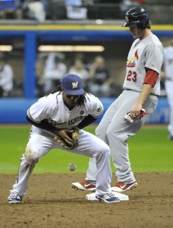 Brewers' second baseman Rickie Weeks drops the ball during game 6 of NLCS in Milwaukee, Wisconsin