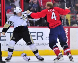 Pittsburgh Penguins' Arron Asham fights with Washington Capitals' John Erskine in Washington