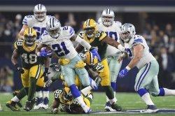 Dallas Cowboys running back Ezekiel Elliott runs for a first down