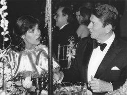 President Ronald Reagan and Princess Caroline of Monaco at a gala dinner
