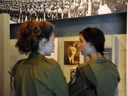 Israeli soldiers look at exhibitions in the Yad Vashem Holocaust Museum in Jerusalem on the eve of Israel's Holocaust Remembrance Day