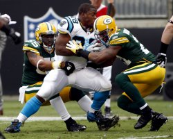 Carolina Panthers running back Jonathan Stewart carries against the Green Bay Packers